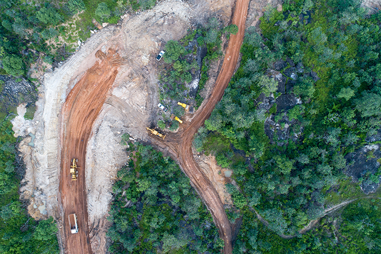 Aerial view of construction at a large scale mine (By Bannafarsai_shutterstock)