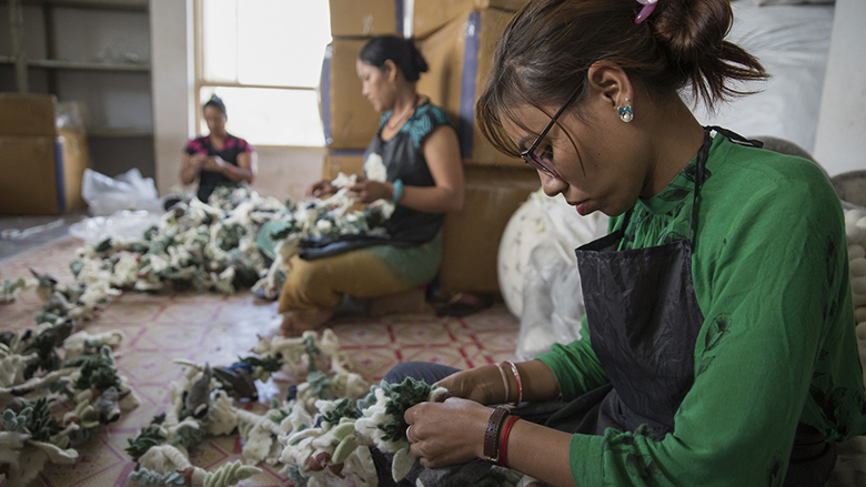 Women stitch handicrafts at Everest Fashion Fair Craft in Lalitpur, Nepal. © Peter Kapuscinski/World Bank