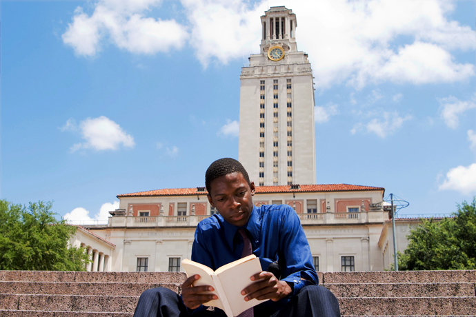 A student with University of Texas at Austin Tower in the background. © qingwa/iStock