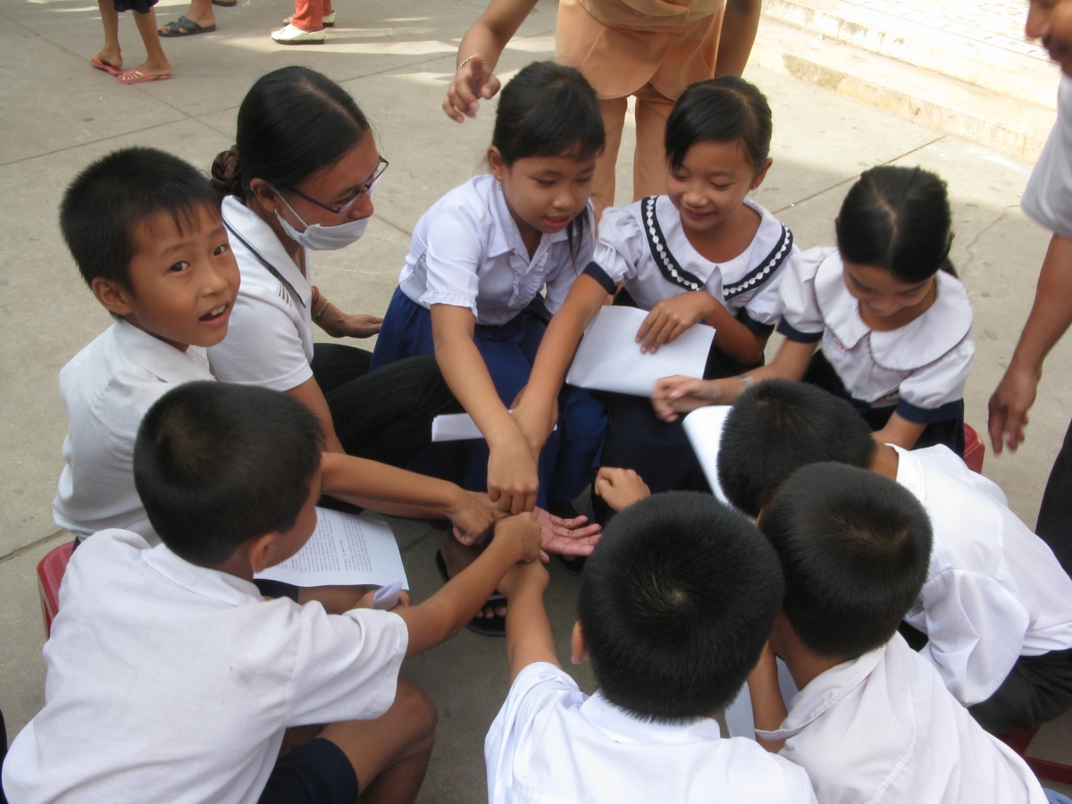 School children in Vietnam practice washing their hands with soap.